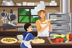 Mother son in the kitchen. A vector illustration of mother and son preparing pizza dough together in the kitchen Stock Images