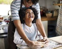 Mother and son kneading dough in the kitchen royalty free stock photo