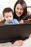Mother and son with laptop Royalty Free Stock Images