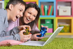 Mother and son with laptop Stock Photography