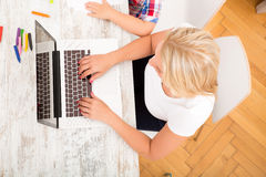 Mother and son with a laptop at home Royalty Free Stock Images