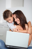 Mother and son with laptop womputer Stock Photos