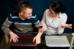 Mother and son with laptops Stock Images