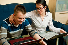 Mother and son with laptops Royalty Free Stock Images
