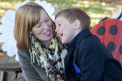 Mother and son laughing. Portrait of attractive blond mother laughing and joking with her young son outside stock photos