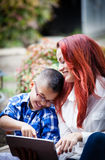 Mother and son laughing while together on  a touch pad Royalty Free Stock Photo