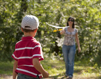 Mother and son launching toy glider Stock Photography