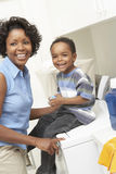 Mother And Son In Laundry Room stock images