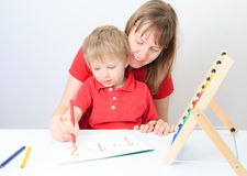 Mother and son learning math. Early education royalty free stock photo