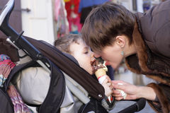 Mother and son lick ice cream Royalty Free Stock Images