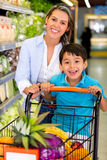 Mother and son at the local market Royalty Free Stock Photo