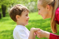 Mother and son look against each other Royalty Free Stock Photo