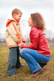 Mother and son  look on each other Stock Images