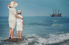 Mother with son look together on the ship in the sea Royalty Free Stock Image