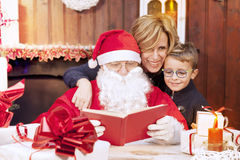 Mother and son look at wish list Stock Photos