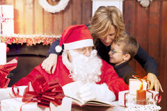 Mother and son look at wish list Stock Photography