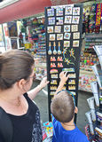 Mother and son looking at Barcelona memorabilia and souvenir Stock Photo