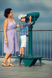 Mother and son looking through binoculars Royalty Free Stock Images