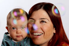 Mother and son looking at bubbles Stock Photo