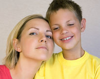 Mother and son looking happy Stock Photos