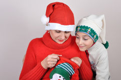 Mother and son looking inside the Christmas stocking Royalty Free Stock Photos