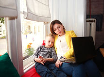 Mother and son looking at laptop at home in room Royalty Free Stock Image