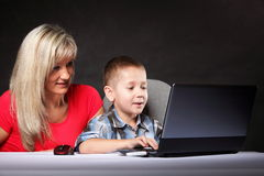 Mother with son looking on the laptop Royalty Free Stock Image