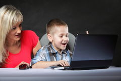 Mother with son looking on the laptop Royalty Free Stock Photography