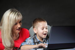 Mother with son looking on the laptop Stock Image