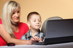 Mother with son looking on the laptop Stock Images