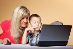 Mother with son looking on the laptop Stock Photography