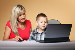 Mother with son looking on the laptop Stock Photo