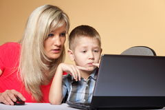 Mother with son looking on the laptop Royalty Free Stock Photo