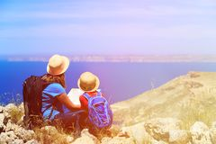 Mother and son looking at map in mountains Royalty Free Stock Image