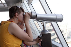 Mother with son looking through pay binoculars Royalty Free Stock Photography