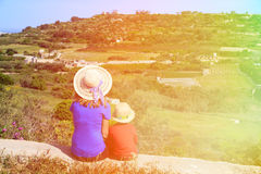 Mother and son looking at scenic country views in. Malta, Europe Royalty Free Stock Photo