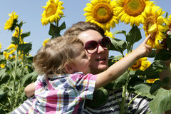 Mother and son looking at sunflowers Royalty Free Stock Photo