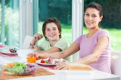 Mother and son lunch, eating smile. Mother and son lunch, eating happy smile stock image