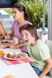 Mother and son lunch, eating smile. Mother and son lunch, eating happy smile stock photography