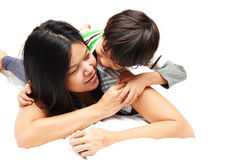 Mother And Son Lying In Bed Royalty Free Stock Photos