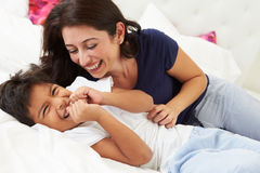 Mother And Son Lying In Bed Together Stock Image