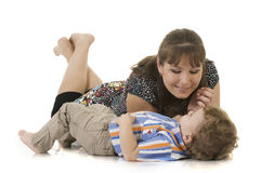 Mother and son lying on the floor Stock Photo