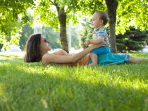 Mother and son lying on the grass. Stock Image