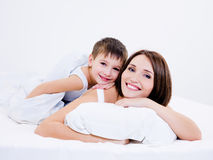 Mother and son lying together on a bed Stock Photo