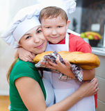 Mother with son making bread Stock Images