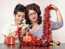 Mother and son making Christmas presents and decorations Royalty Free Stock Photos