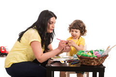 Mother and son making Easter decorations Stock Photo
