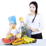 Boy and mom making healthy juice - isolated Royalty Free Stock Images