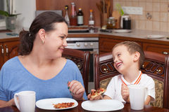 Mother and son making pizza together. At home (focus on the boy stock images