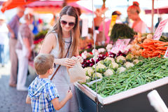 Mother and son at market Stock Photo